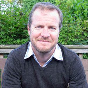 Portrait photograph of Alan Hills